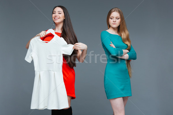 Happy cheerful young woman and envious angry female on shopping   Stock photo © deandrobot