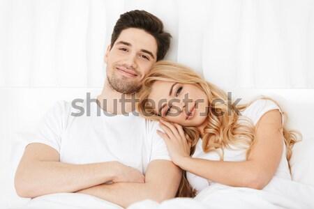 Dos sonriendo jóvenes ninas blanco cama Foto stock © deandrobot