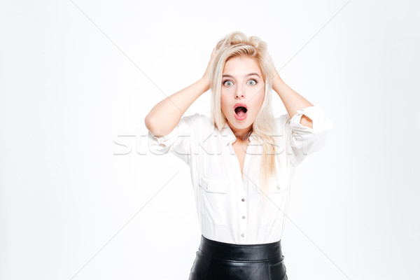 Young blonde businesswoman shouting and covering her ears with hands Stock photo © deandrobot