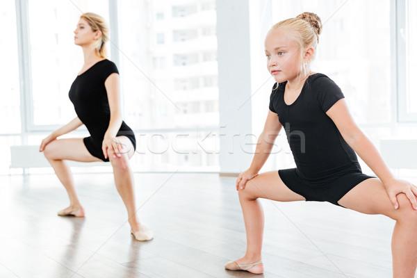 Beautiful little dancer and her dancing teacher in a studio Stock photo © deandrobot