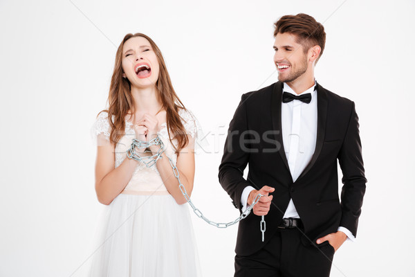 Man binding his woman with chain Stock photo © deandrobot