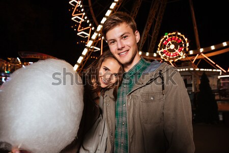 Couple eating cotton candy and having fun in amusement park Stock photo © deandrobot
