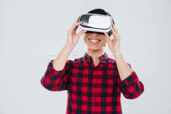 Boldog fiatal ázsiai férfi visel virtuális Stock fotó © deandrobot