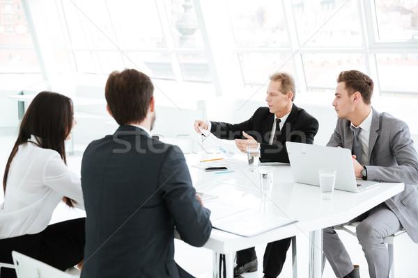 üzleti csoport ül asztal konferenciaterem laptopok számítógép Stock fotó © deandrobot
