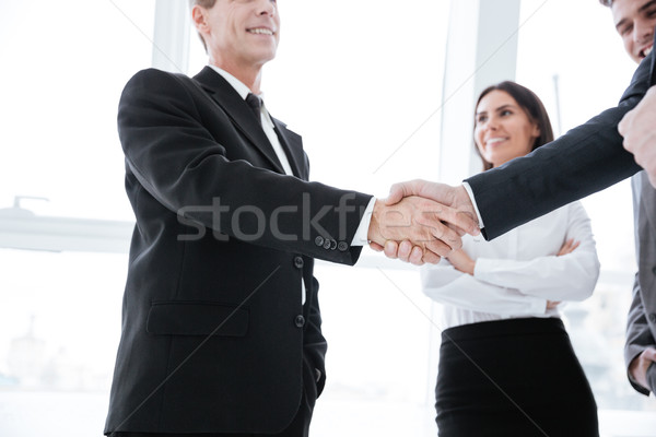 Business people shaking hands Stock photo © deandrobot