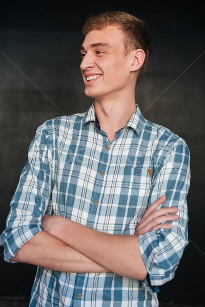 Smiling man in shirt Stock photo © deandrobot