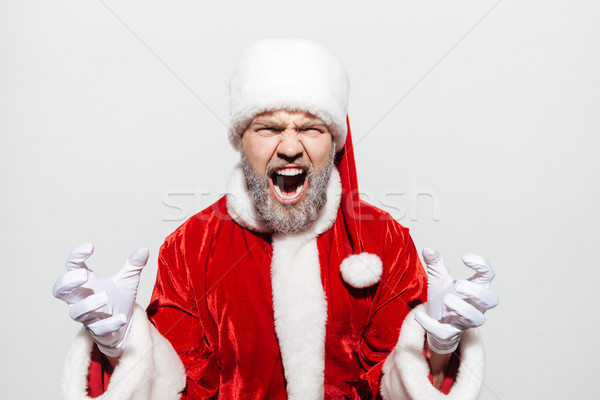 Mad irritated man santa claus standing and shouting Stock photo © deandrobot