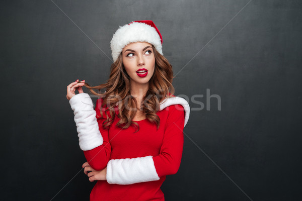 Mystery woman in christmas costume looking away Stock photo © deandrobot