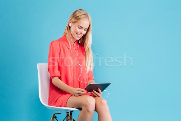 笑みを浮かべて 赤いドレス イヤホン タブレット 肖像 ストックフォト © deandrobot