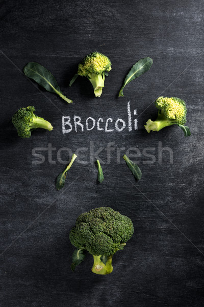 Broccoli over dark chalkboard background. Stock photo © deandrobot