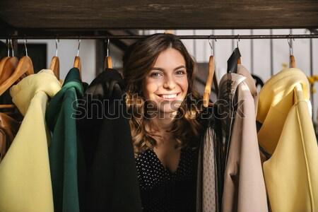 Jeunes dame permanent vêtements Photo stock © deandrobot