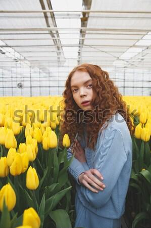 Lány rejtőzködik virágok vörös hajú nő sárga virágok nő Stock fotó © deandrobot