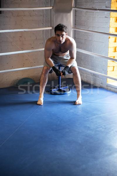 молодые Боксер сидят углу бокса кольца Сток-фото © deandrobot