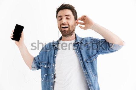 Feliz hombre ventilador ganar desgaste dedo Foto stock © deandrobot