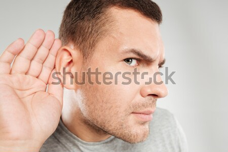 Concentrated man tries to hear you. Stock photo © deandrobot