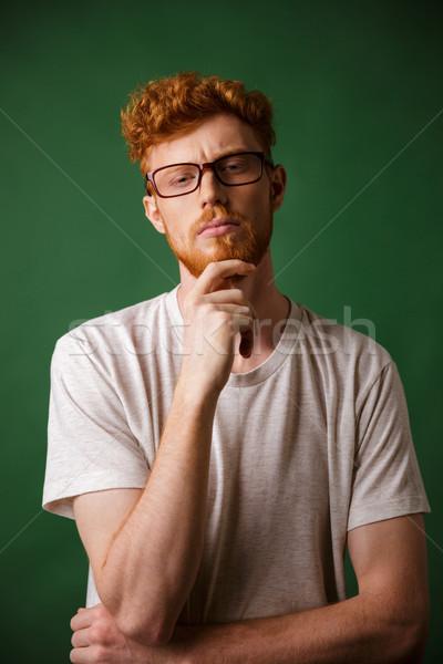 портрет задумчивый человека очки Сток-фото © deandrobot
