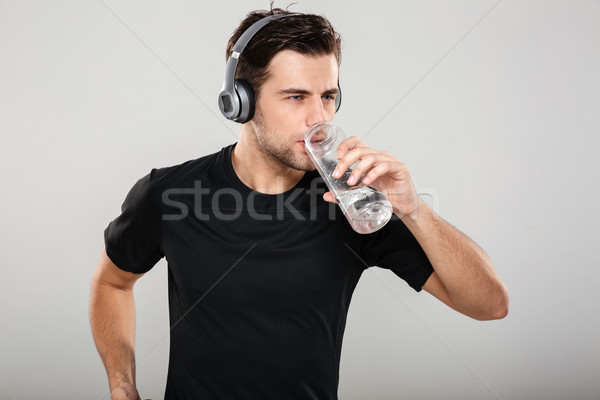Portrait of a young attractive sportsman Stock photo © deandrobot