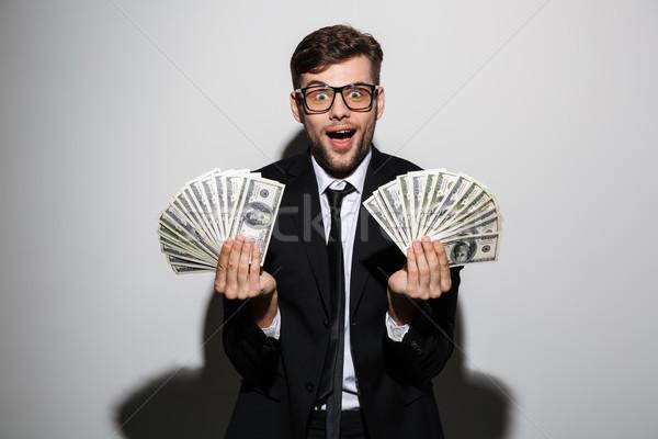 Mutlu adam gözlük siyah takım elbise iki Stok fotoğraf © deandrobot