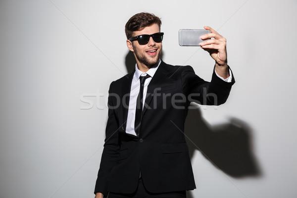 クール あごひげを生やした 男 黒服 携帯電話 ストックフォト © deandrobot