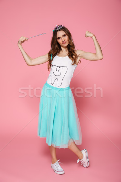 Full length portrait of funny young woman dressed like princess  Stock photo © deandrobot