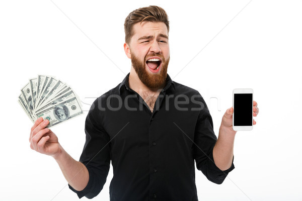 Happy bearded business man in shirt holding money Stock photo © deandrobot