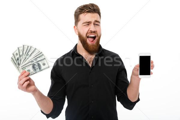 Felice barbuto uomo d'affari shirt soldi Foto d'archivio © deandrobot