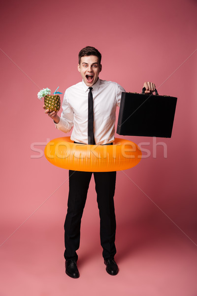 Glücklich aufgeregt jungen Geschäftsmann Gummi Ring Stock foto © deandrobot