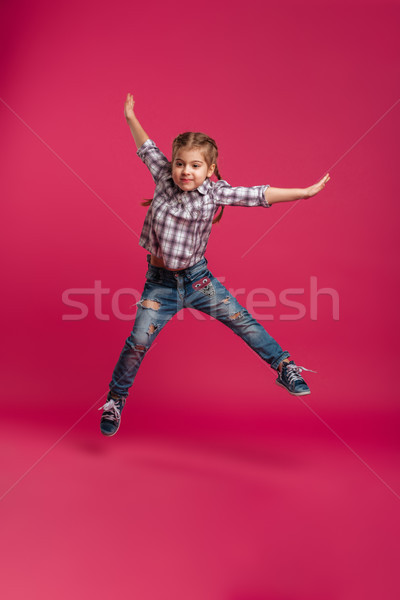 Little girl child jumping isolated Stock photo © deandrobot