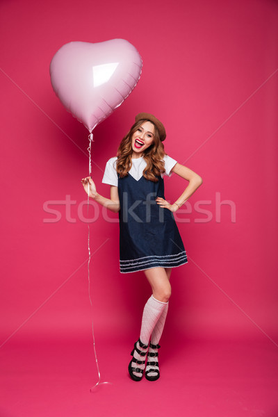 Happy beautiful lady in dress holding air balloon isolated Stock photo © deandrobot