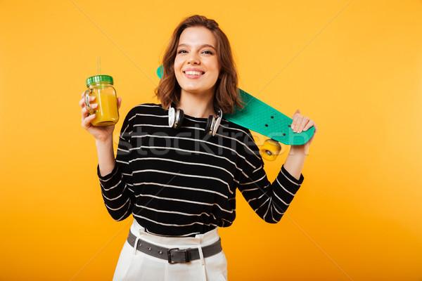 Portré boldog lány tart gördeszka vállak koktél Stock fotó © deandrobot