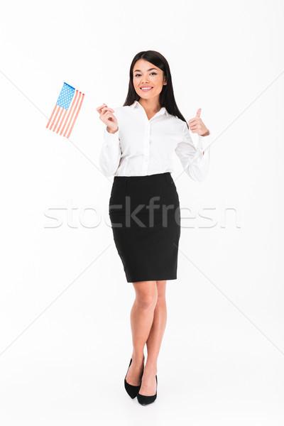 Teljes alakos portré ázsiai üzletasszony tart amerikai zászló Stock fotó © deandrobot