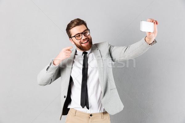 Portrait of a happy businessman dressed in suit Stock photo © deandrobot