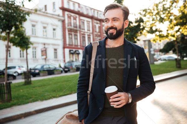 Portrait of a smiling bearded man drinking coffee Stock photo © deandrobot