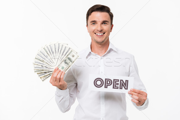 Portrait of a happy smiling man in white shirt Stock photo © deandrobot