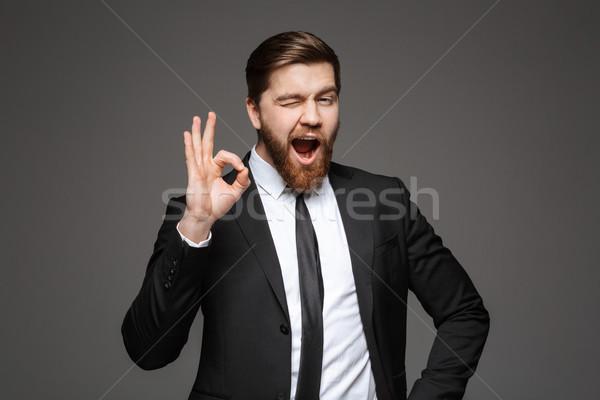 Portrait of a happy young businessman Stock photo © deandrobot