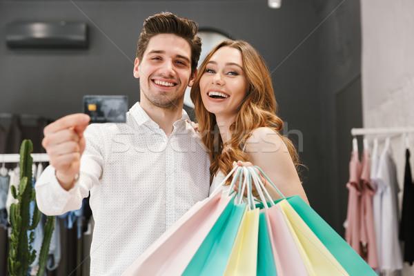 Feliz compras roupa juntos roupa Foto stock © deandrobot