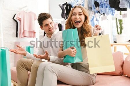 Boldog fiatal pér ül ruházat bolt bevásárlótáskák Stock fotó © deandrobot