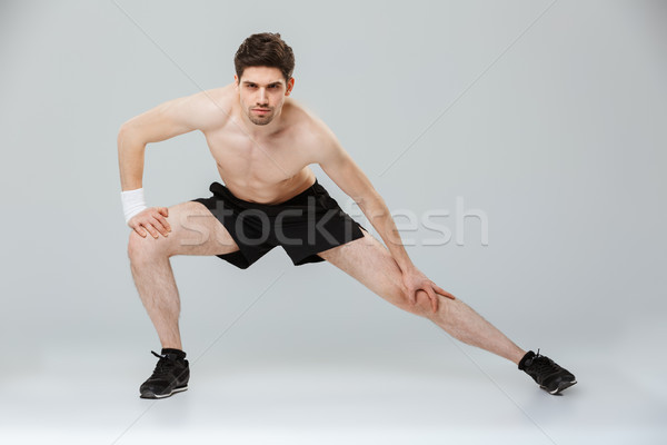 Full length portrait of a focused young half naked sportsman Stock photo © deandrobot
