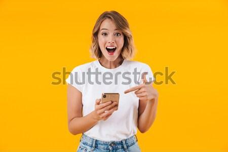 Excitado teléfono móvil imagen pie Foto stock © deandrobot