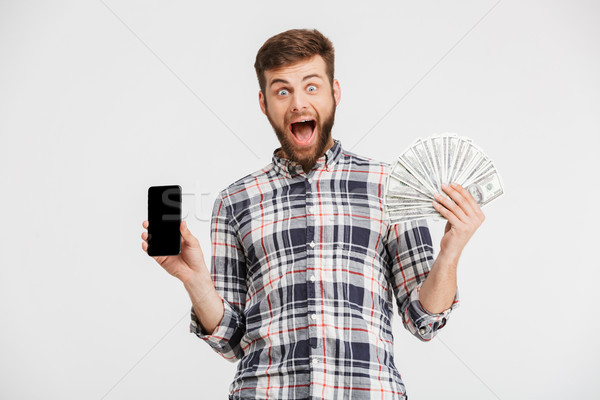 Portrait of a smiling young man in plaid shirt Stock photo © deandrobot