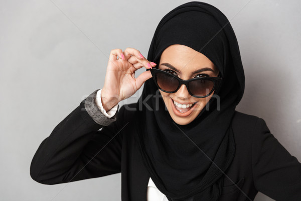 Portrait closeup of stylish muslim woman 20s in religious headsc Stock photo © deandrobot