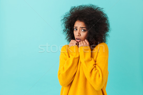 Image closeup of scared woman with shaggy hair pressing arms in  Stock photo © deandrobot