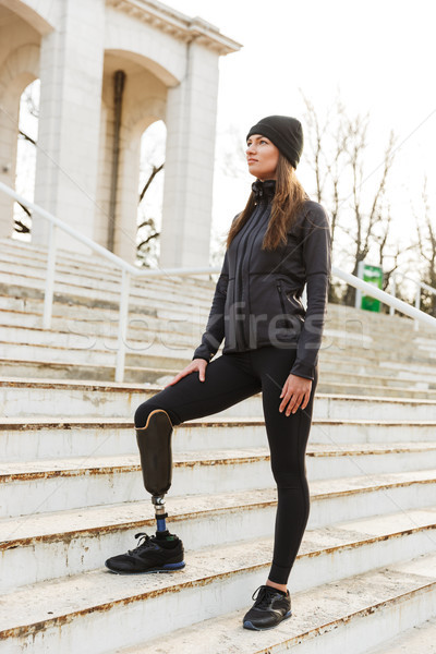 Photo of caucasian disabled woman in sportswear with prosthetic  Stock photo © deandrobot