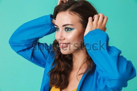 Image belle femme 20s imperméable Photo stock © deandrobot