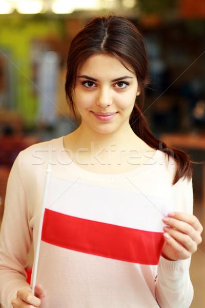 Feliz femenino estudiante bandera Polonia Foto stock © deandrobot