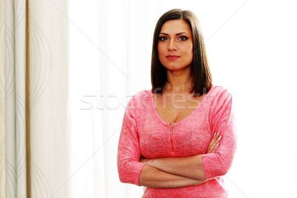 Portrait jeunes belle femme bras pliées fille Photo stock © deandrobot