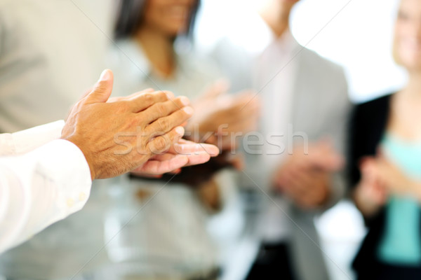Close-up of business people clapping hands. Business seminar concept Stock photo © deandrobot