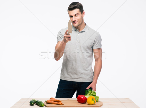 Férfi saláta kacsintás kamera boldog fiatalember Stock fotó © deandrobot