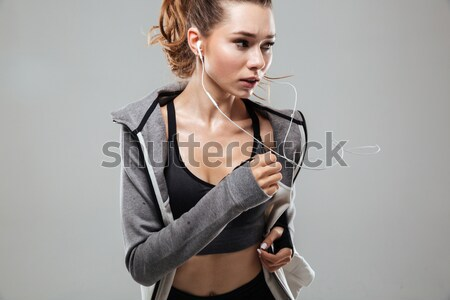Tired fitness man with towel and bottle with water Stock photo © deandrobot
