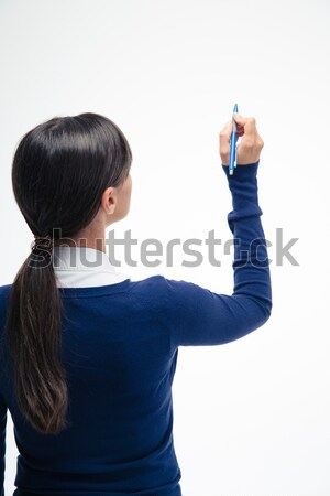 Businesswoman writing something on invisible screen Stock photo © deandrobot